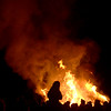 JIM VAIKNORAS/Staff photo Flames from burning Christmas Trees climb high into the night at the Annual Olde Newbury Bonfire at the Tendercrop Farm growing fields Saturday night.  The event included local food and drink venders an auction, photo booth, and of course an enormous fire.