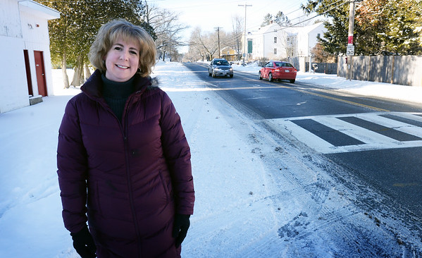 BRYAN EATON/Staff photo. American Automobile Association Northeast's Traffic Safety Hero of the Year Christine Wallace at the crosswalk at Pioneer Park on Merrimac Street in Newburyport.