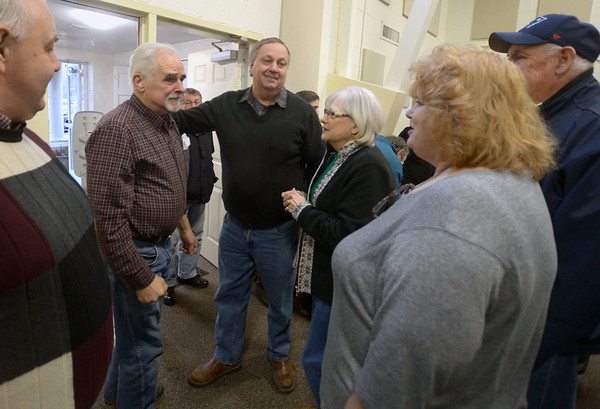 JIM VAIKNORAS/Staff photo  Dick Brunault talks with well wishers at his and his son Matt's retirement party at West Newbury Town hall Annex Sunday afternoon  The Brunault's recently sold their Main Street garage and over 200 people showed up at a surprise party in their honor.