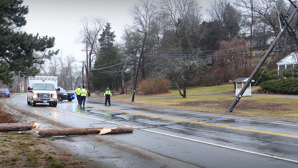 BRYAN EATON/Staff photo. Monday's strong wind toppled one utility line and compromised another on High Road in Newbury a couple hundred yards north of the Lower Green. The roadway was closed until utility crews could arrive.
