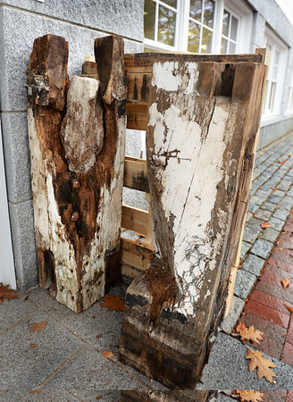 BRYAN EATON/File photos. Over two years of work on renovation of the First Religious Society's church and steele, also known as the Unitarian Church. Rotted posts sat outside the church offices in November of 2015 Note the concrete that had been put into one of them from repair work years ago to the steeple of the Unitarian Universalist Church.