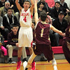 JIM VAIKNORAS/Staff photo Amesbury's Christopher Chabot shots over Newburyport's Robert Shay during their game at Amesbury High School Tuesday.