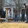 JIM VAIKNORAS/Staff photo A clique of photographers wait Monday afternoon to take photos of an owl living in a tree on Kent Street in Newburyport.