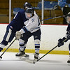 BRYAN EATON/File photos. Triton hosts Lynnfield. Triton's Sam Rennick is covered by two Lynnfield players.