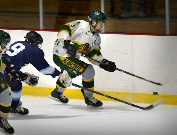 BRYAN EATON/Staff photo. Pentucket hosts Triton. Triton's Sam Rennick puts pressure on Pentucket forward Ben Gardner.