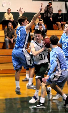 JIM VAIKNORAS/Staff photo Pentucket's  Spencer Pacy drives to the basket between Triton's Cameron Wiley and Christopher Trotta during their game at Pentucket Wednesday.