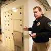 BRYAN EATON/Staff photo. Salisbury town planning director Lisa Pearson and police chief Thomas Fowler gave a tour of the soon-to-be-opened new police station. Chief Fowler shows off lockers to hold evidence collected including a refridgerated one for biological collections.