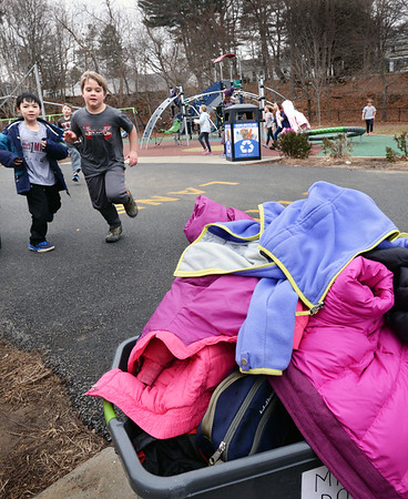 BRYAN EATON/Staff photo. Third-graders at the Bresnahan School piled up their coats as they played at recess in above normal temperatures on Thursday. The weekend is forecast to be cooler, but sunny.