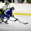BRYAN EATON/Staff photo. Pentucket hosts Triton. Triton defensman moves the puck past Pentucket's Josh Smith.