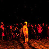 JIM VAIKNORAS/Staff photo Ciders  from burning Christmas Trees float down on the crowd at the Annual Olde Newbury Bonfire at the Tendercrop Farm growing fields Saturday night.  The event included local food and drink venders an auction, photo booth, and of course an enormous fire.