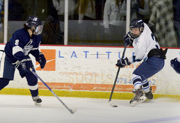 BRYAN EATON/File photos. Triton hosts Lynnfield. Triton's Jed Cutter, right, slides the puck down rink.
