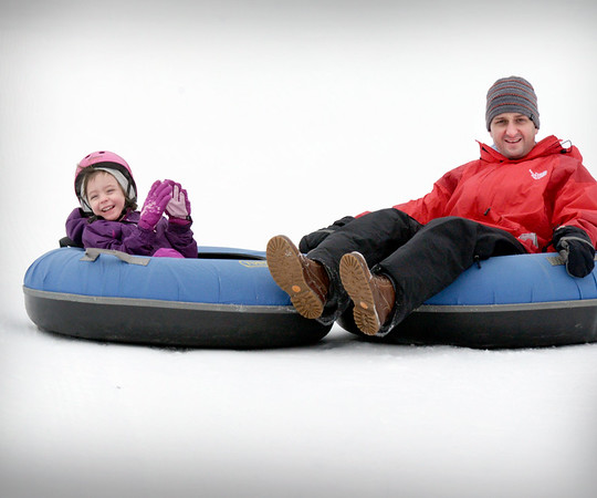 BRYAN EATON/Staff photo. Though rain was in the forecast for Thursday afternoon there was plenty of snow at the Amesbury Sports Park for those on school vacation to enjoy. Mya Galvin, 5, and her dad Pate of Merrimac got some snow tubing in on Thursday morning.