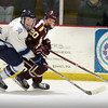 BRYAN EATON/Staff photo. Triton's Josh Price and Newburyport forward Jacob Grossi-Hogg look to catch the puck.