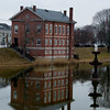JIM VAIKNORAS/Staff photo The Superior Court and teh Swan Fountain are reflected in the still water of teh Frog Pond at the Bartlet Mall in Newburyport early Saturday morning.