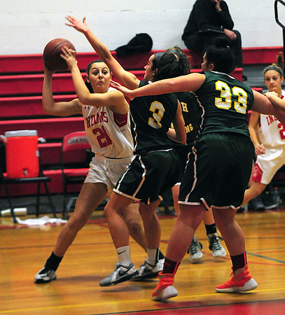 JIM VAIKNORAS/Staff photo Amesbury's Allison Napoli gets ready to make a move drives to the basket against North Reading during their game at Amesbury High School Friday night.
