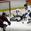 BRYAN EATON/Staff photo. Triton's Joey Conte assists goalie Ben Fougere with a shot on net.