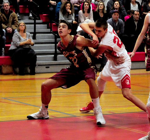 JIM VAIKNORAS/Staff photo Amesbury's Zachary Labrecque is boxed out by Newburyport's Casey McLaren during their game at Amesbury High School Tuesday.