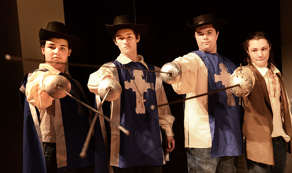 BRYAN EATON/Staff photo. Amesbury High School production of the Three Musketeers. The Three Musketeers from left, Michael Lynch as Athos; Benjamin LeBlanc as Aramis; Alex Roberts as Porthos and Chris Marrama as D'Artagnan.