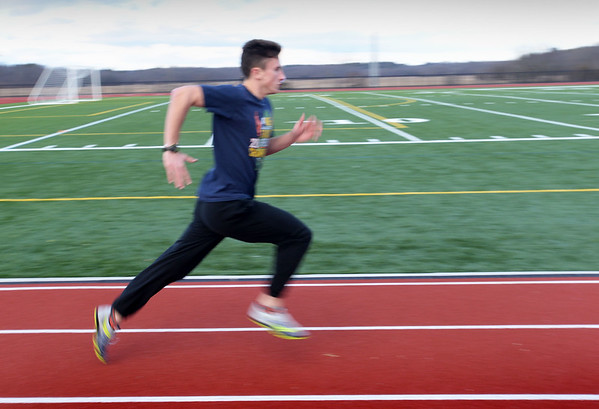 BRYAN EATON/Staff photo. Triton track runner Brandon Amello.