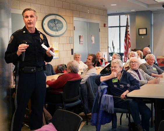 BRYAN EATON/Staff photo. Amesbury police chief Kevin Ouellet speaks to residents at the Amesbury Senior Center on Tuesday morning. He and fire chief Ken Berkenbush speak once a month at Breakfast With the Chiefs to give timely advice on a range of safety-related subjects.