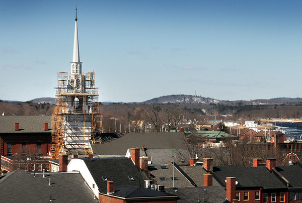 BRYAN EATON/File photos. Over two years of work on renovation of the First Religious Society's church and steele, also known as the Unitarian Church. BRYAN EATON/Staff Photo. The steeple of the Unitarian Universalist Church loomed over downtown Newburyport in a view from the top of the city's housing authority's Sullivan Building in March of 2015. Costs of renovation work on Newburypoprt's tallest and elegant steeple, had doubled at the time with more problems than anticipated.