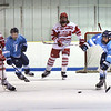 BRYAN EATON/Staff photo. Masconomet's Jack Corcoran and Triton's Christian O'Brien move in for a loose puck.