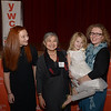 JIM VAIKNORAS/Staff photo Nacey Peace Award recipient Hannah Wilson and Kat Preftes, holding her daughter Kaya stand on either side of guest speaker Jenifer Yanco at the Annual MLK celebration at Newburyport City Hall Friday night.