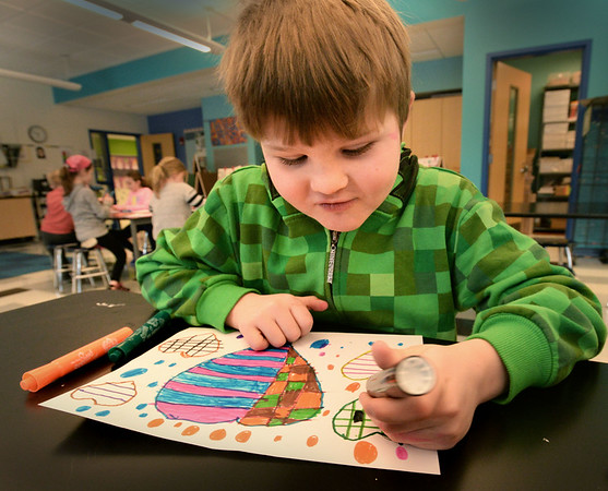 BRYAN EATON/Staff photo. Second-grader Matthew Veader, 7, makes creative Valentine designs in Pam Jamison's art class at the Bresnahan School on Monday. The artwork is a fundraiser for the school's PTO. Parents can order their child's artwork that can be printed on a mug, t-shirt and other items.