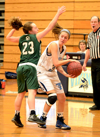 BRYAN EATON/Staff photo. Triton's Melanie Primpas is covered by Kaitlyn O'Connell.