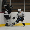 JIM VAIKNORAS/Staff photo Haverhill'sAmanda Regan  from North Andover digs for the puck during the game against Somerville at Veteran's Rink in Haverhill Saturday.