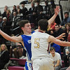 JIM VAIKNORAS/Staff photo Georgetown's Hunter Lane guards Newburyport's Cameron MacRea during their game at Newburyport High School Friday night.
