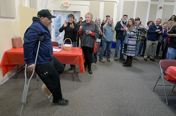 JIM VAIKNORAS/Staff photo  Matt Brunault walks into his and his dad's retirement party at West Newbury Town hall Annex Sunday afternoon to a round of applause. The Brunault's recently sold their Main Street gararge and over 200 people showed up at a surprise party in their honor.