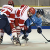 BRYAN EATON/Staff photo. Triton's Sean Hirtle moves the puck past Masconomet's Joe Flak.