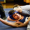 BRYAN EATON/Staff photo. Triton hosts Peabody wrestling. Peabody's Jon Salmeron is almost pinned by Triton's Lewi L'Heureux.