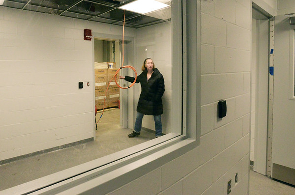 BRYAN EATON/Staff photo. Salisbury town planning director Lisa Pearson and police chief Thomas Fowler gave a tour of the soon-to-be-opened new police station. Lisa Pearson shows the sally port, where prisoners are driven in, which opens to a holding cell and then into the booking room.