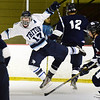 BRYAN EATON/File photos. Triton hosts Lynnfield. Triton forward Ricky Calvani clashes with Lynnfield defenders.
