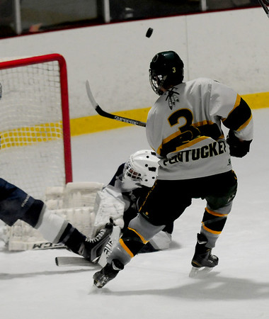 JIM VAIKNORAS/Staff photo Hamilton goalie Finn Brody makes a save on Pentyucket's Ben Gardner Saturday in Haverhill.