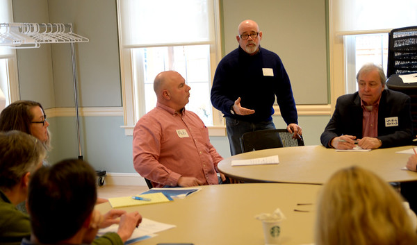 JIM VAIKNORAS/Staff photo  Newburyport School Committee member Bruce Menin speaks at a budget workshop at the Senior Center in Newburyport Saturday morning.