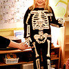 BRYAN EATON/Staff photo. Youngsters have been learning about the human body with eyes, noses, ears and also about the skeleton at the Newburyport Montessori School. Josie Wizda, 4, dressed up in a skeleton costume and children stuck labels on indentifying the different bones.