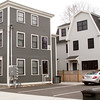 BRYAN EATON/Staff photo. The Newburyport city council rejected a $40,00 fine for builder who made the house too tall, at right, at Lime and Prospect Streets. It's located behind the gymnasium at the Brown School.