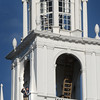 BRYAN EATON/File photos. Over two years of work on renovation of the First Religious Society's church and steele, also known as the Unitarian Church. Finishing touches of paint to the steeple took place last fall.