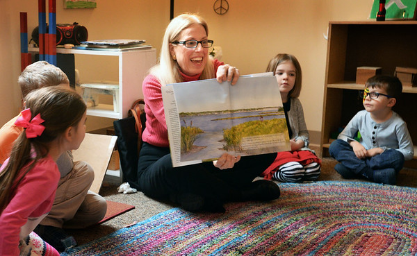 """BRYAN EATON/Staff photo. Local author Julie Jewett visited the Newburyport Montessori School to read her book """"Wings On the Wind"""" to several classes. The book is about a young girl who lives on the marsh and watches a duckling as it matures."""