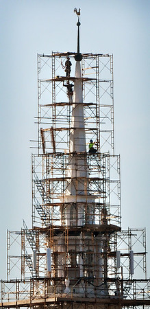 BRYAN EATON/File photos. Over two years of work on renovation of the First Religious Society's church and steele, also known as the Unitarian Church. Scaffolding is almost completed in August of 2014.