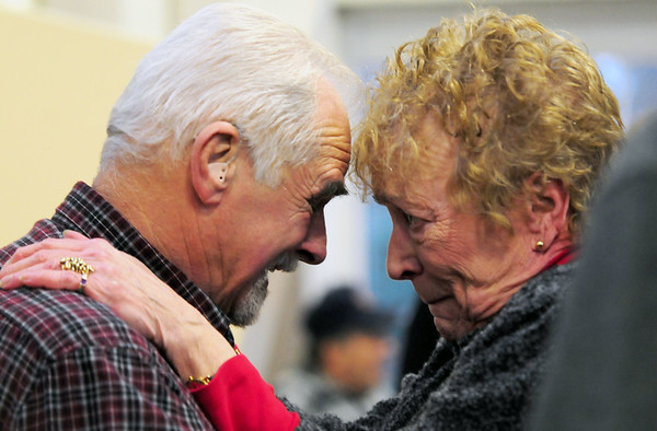 "JIM VAIKNORAS/Staff photo Long time costumer Cheryl Hobson Van Patton hugs Dick Brunault a his retirement party at the Town hall Annex. ""He always took care of our cars, even in the middle of the night"" said Van Patton. Dick and his son Matt recently sold their Main Street gararge."