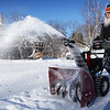 BRYAN EATON/Staff photo. Russell Pike snowblows his Salisbury driveway with some protection fromn the cold with his beard on Sunday. The area got off relatively easy from the storm with around four inches of snow with much higher levels on the south shore and Cape Cod.