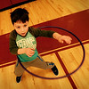 "BRYAN EATON/Staff photo. Blake Fisher, 6, uses a hula hoop, one of several stations, in ""tabata"" a Japanese-influenced routine of 20 seconds of high intensity workout followed by 10 seconds of rest. He and his fellow kindergartners were in physical education class at Newyport's Bresnahan School."