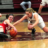 JIM VAIKNORAS/Staff photo Amesbury's Abigail Sartori dives for a loose ball with Newburyport's Katelyn Hadden during their at Newburyport High School.