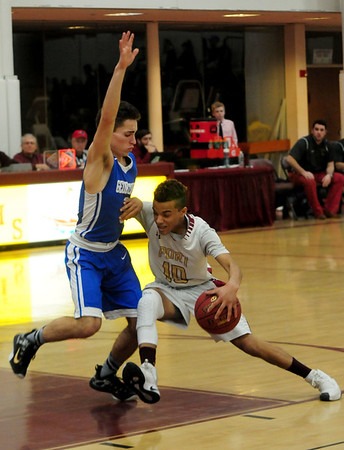 JIM VAIKNORAS/Staff photo  Newburyport's George Coyell drives to the basket against Georgetown during their game at Newburyport High School Friday night.