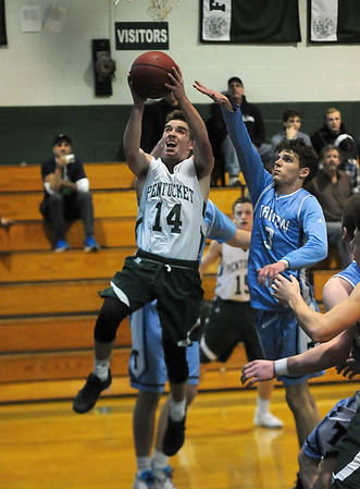 JIM VAIKNORAS/Staff photo Pentucket's Gus Flaherty drives to the basket against  Triton's  during their game at Pentucket Wednesday.