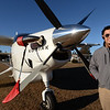 BRYAN EATON/Staff photo. Kane Smith at Plum Island Airfield with a plane he will offer clients use of in a time share arrangement.